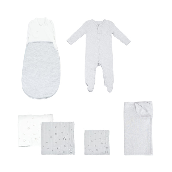 grey and white swaddle set that includes a swaddle bag, two large muslins, one regular muslin, a baby blanket and a front-opening sleepsuit with feet
