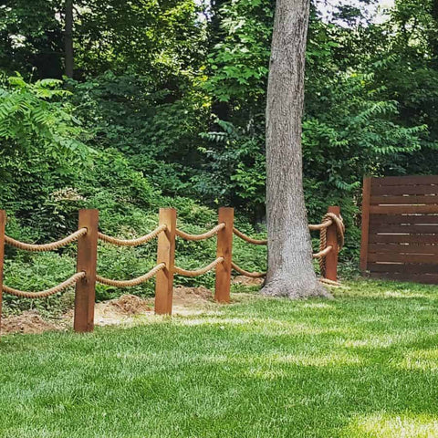 simple outdoor rope fence used to line yard