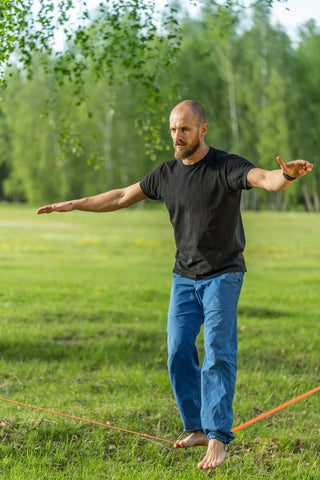 man walking on slack line to test the tensile strength of rope