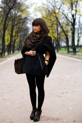Miroslava Duma in all black with animal print scarf