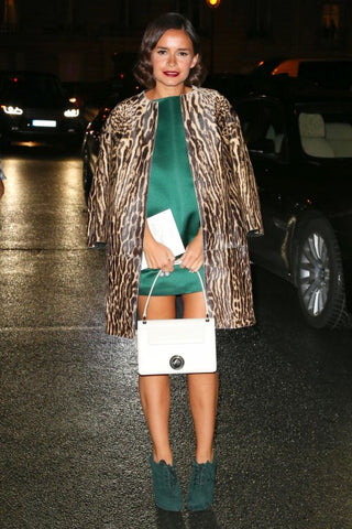 Evening look - Miroslava Duma in emerald grenn shift dress with animal print jacket