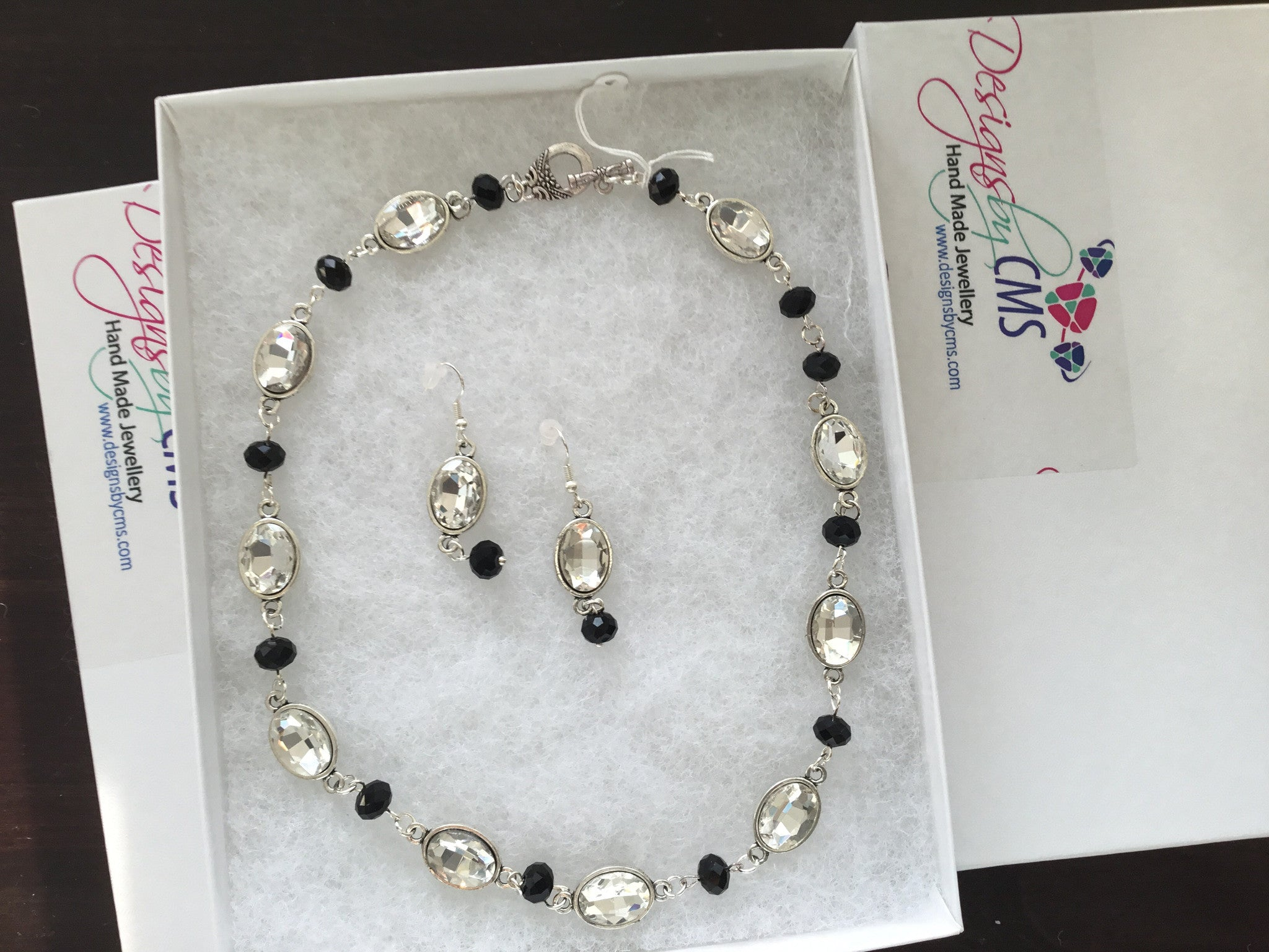 Encased Crystals & Faceted Jet Bead Necklace & Earring Set