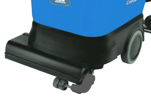 The foot-operated caster is lowered for better mobility between cleaning locations.