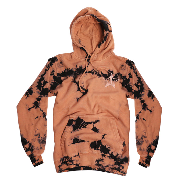 Black and tan tie-dye pull over hooded sweatshirt with small Jeffree Star Cosmetics logo star