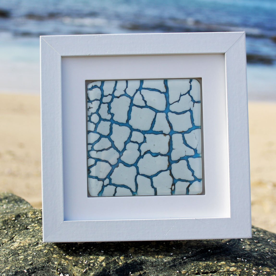 A framed crackle technique piece in glass made by Connemara Blue