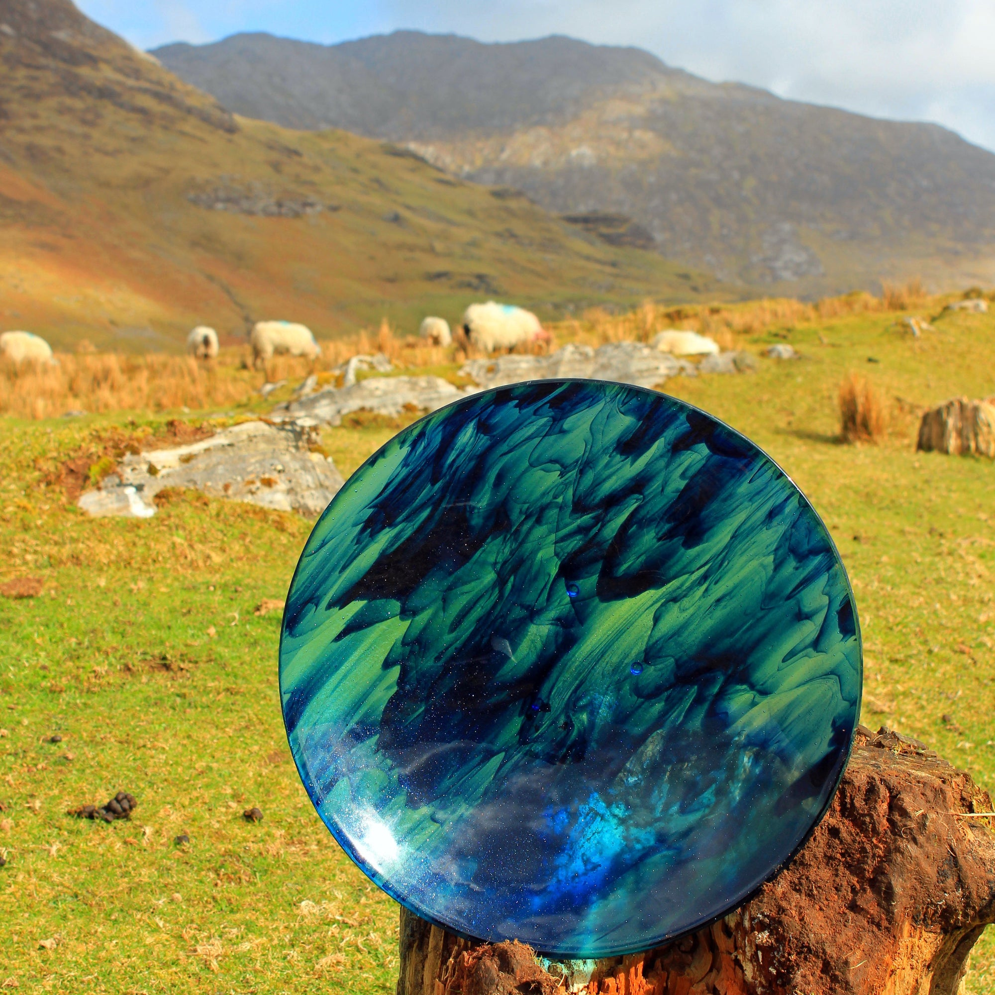 A fused streaky glass bowl made by Connemara Blue