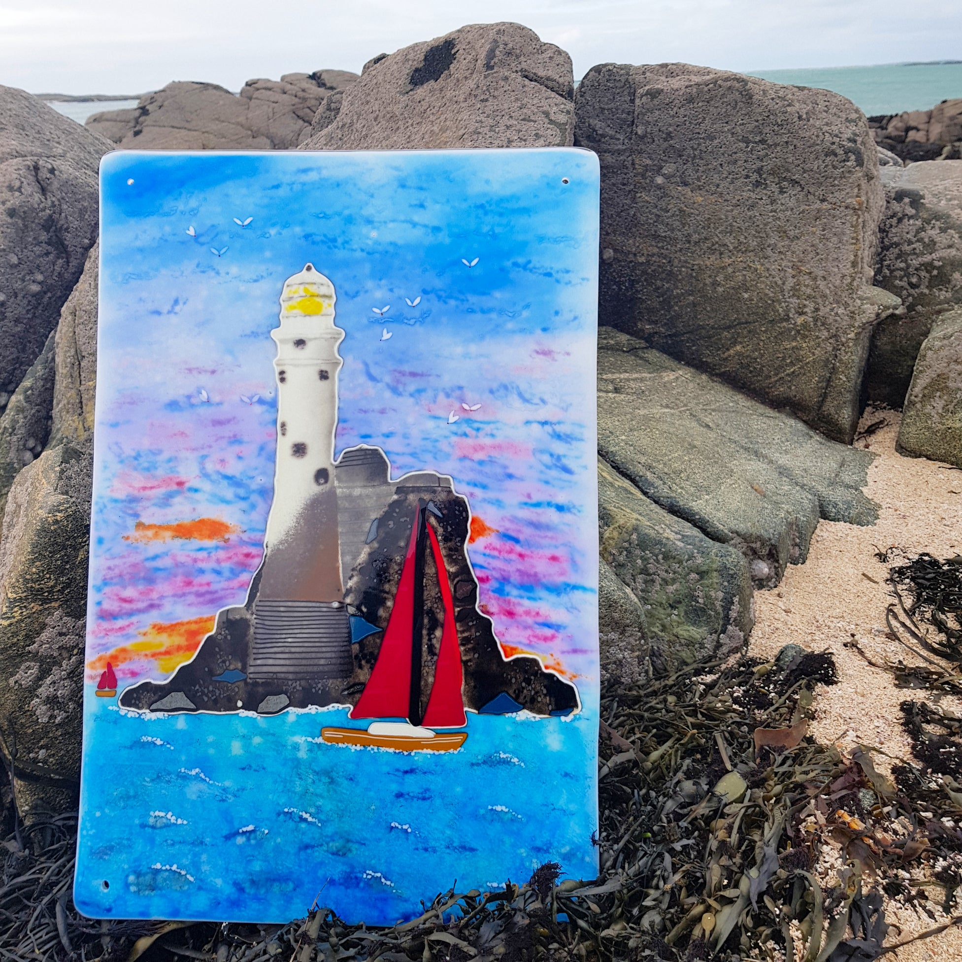 A large fused glass wall panel featuring Fastnet Lighthouse in County Cork, made by Connemara Blue