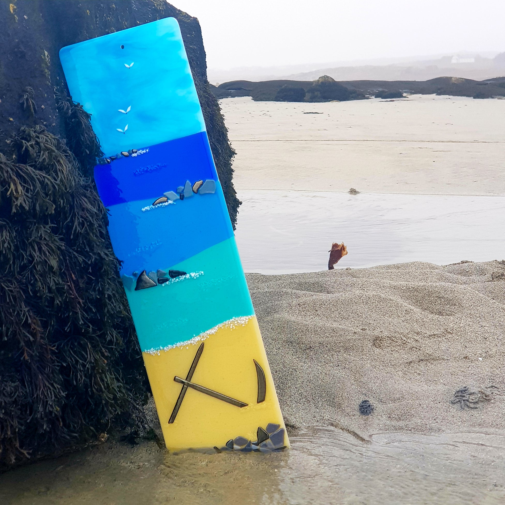 A fused glass panel showing Anchor Beach, made by Connemara Blue
