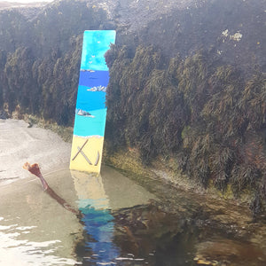 A fused glass wall panel showing Anchor Beach, made by Connemara Blue