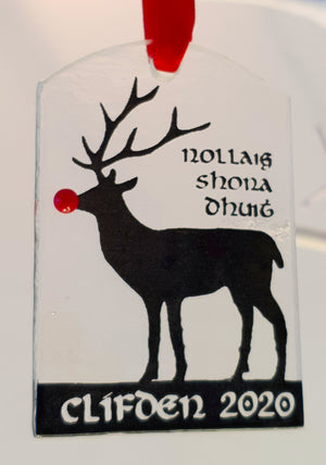 A fused glass Christmas decoration featuring Rudolph the reindeer and Clifden 2020 inscription in black, handmade by Connemara Blue