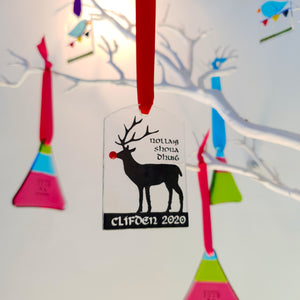 A fused glass Christmas decoration featuring Rudolph the reindeer, handmade by Connemara Blue