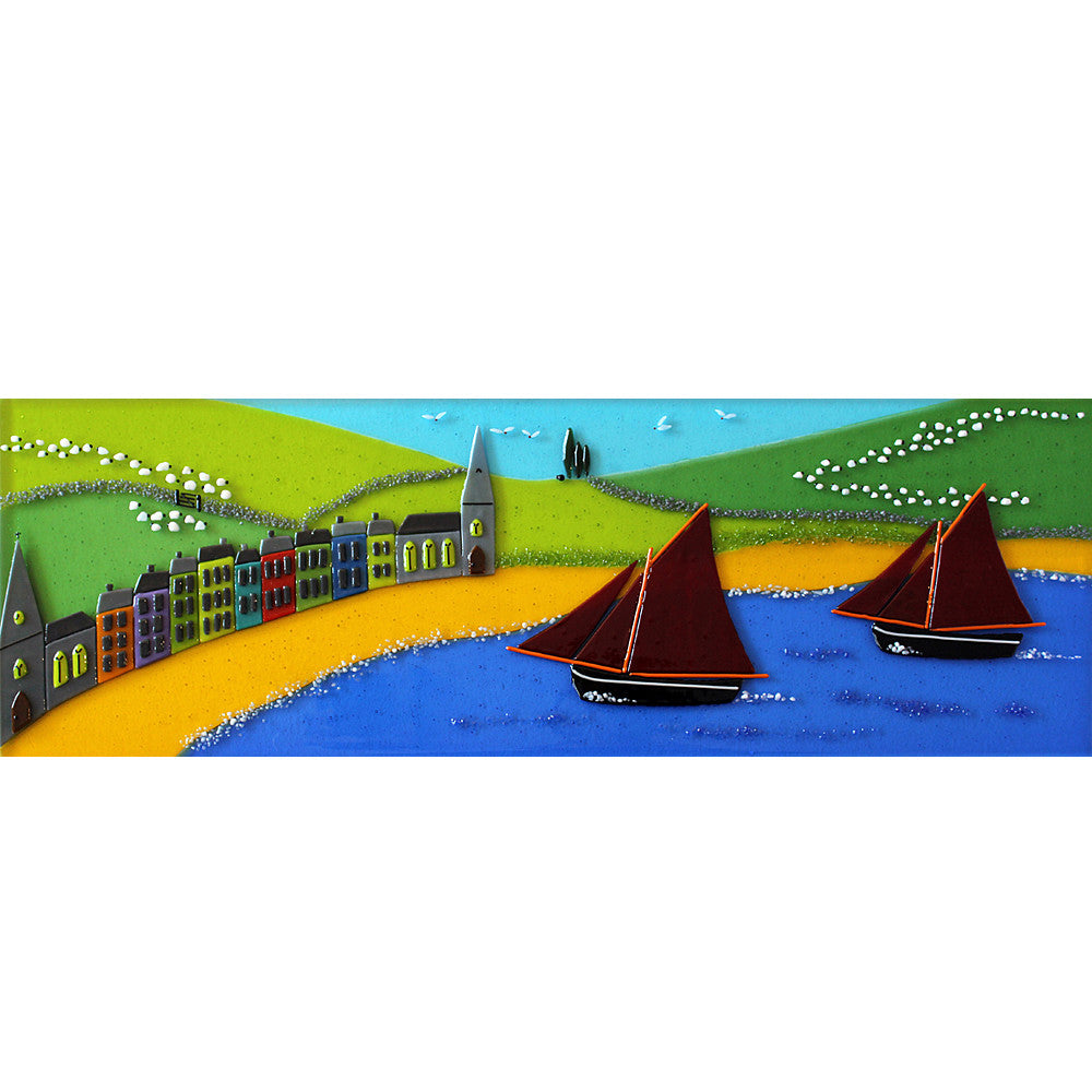A fused glass wall panel depicting Clifden and the Galway Hooker, made by Connemara Blue