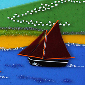 A close up of a Galway Hooker in fused glass, made by Connemara Blue