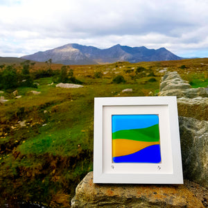 A framed fused glass landscape made by Connemara Blue