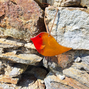 A fused glass hanging decoration in the shape of a charming robin, made by Connemara Blue