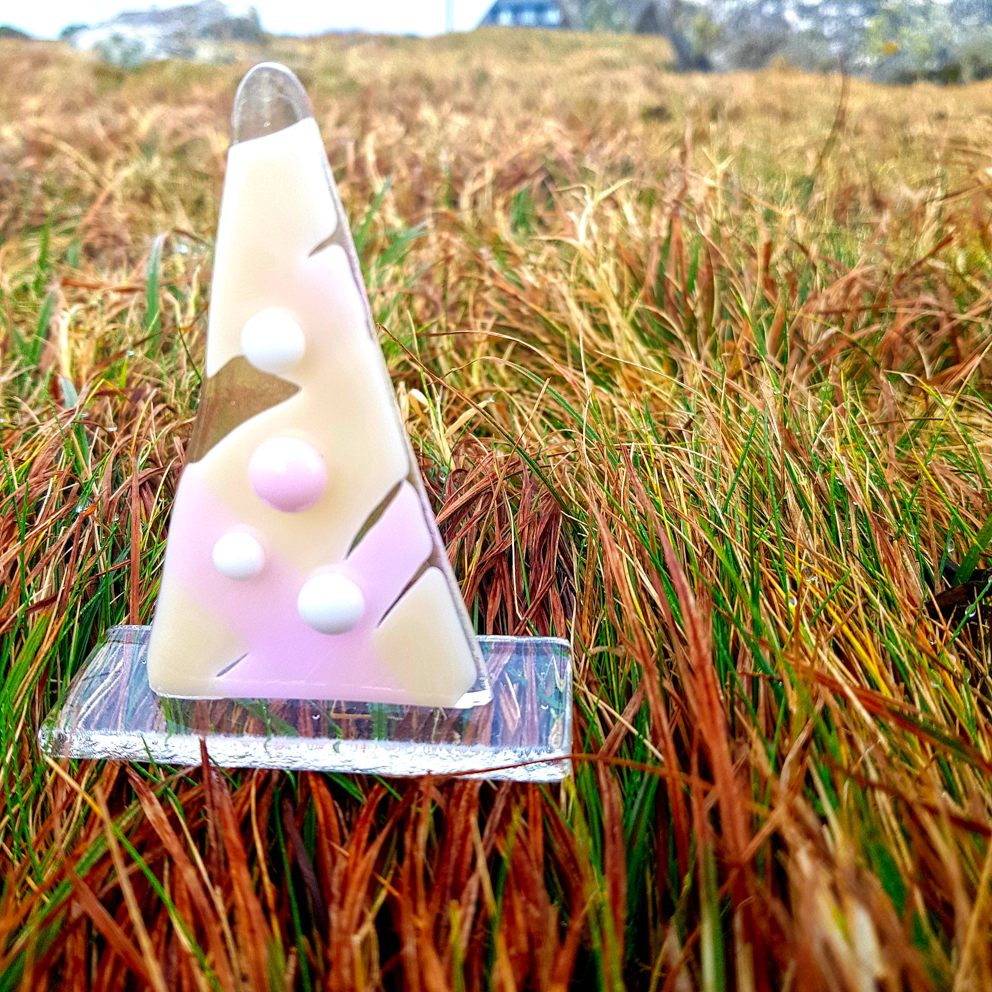 A freestanding tree-shaped sculpture in pink and vanilla, made by Connemara Blue