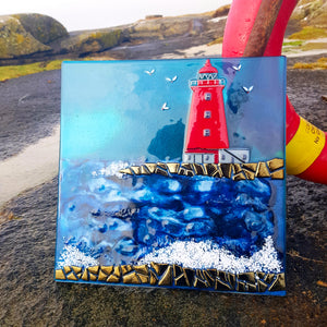 A fused glass wall panel showing Poolbeg Lighthouse, made by Connemara Blue