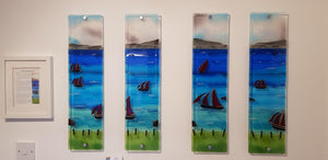 A set of four fused glass wall panels showing a race of Galway Hookers, made by Connemara Blue