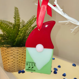 A fused glass Christmas decoration in the form of a Tomte or gnome, handmade by Connemara Blue
