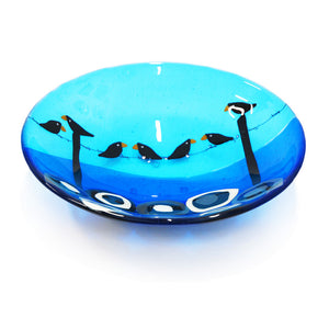 A fused glass bowl featuring black birds on a wire, made by Connemara Blue