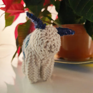 A charming handknitted wool sheep in blue and cream, available at Connemara Blue