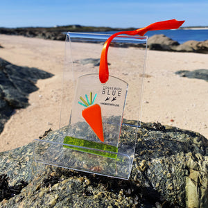 A fused glass decoration featuring a bright orange carrot, handmade by Connemara Blue