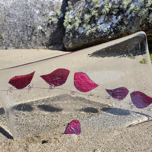 A clear fused glass rectangular plate with copper birds on barbed wire, handmade by Connemara Blue