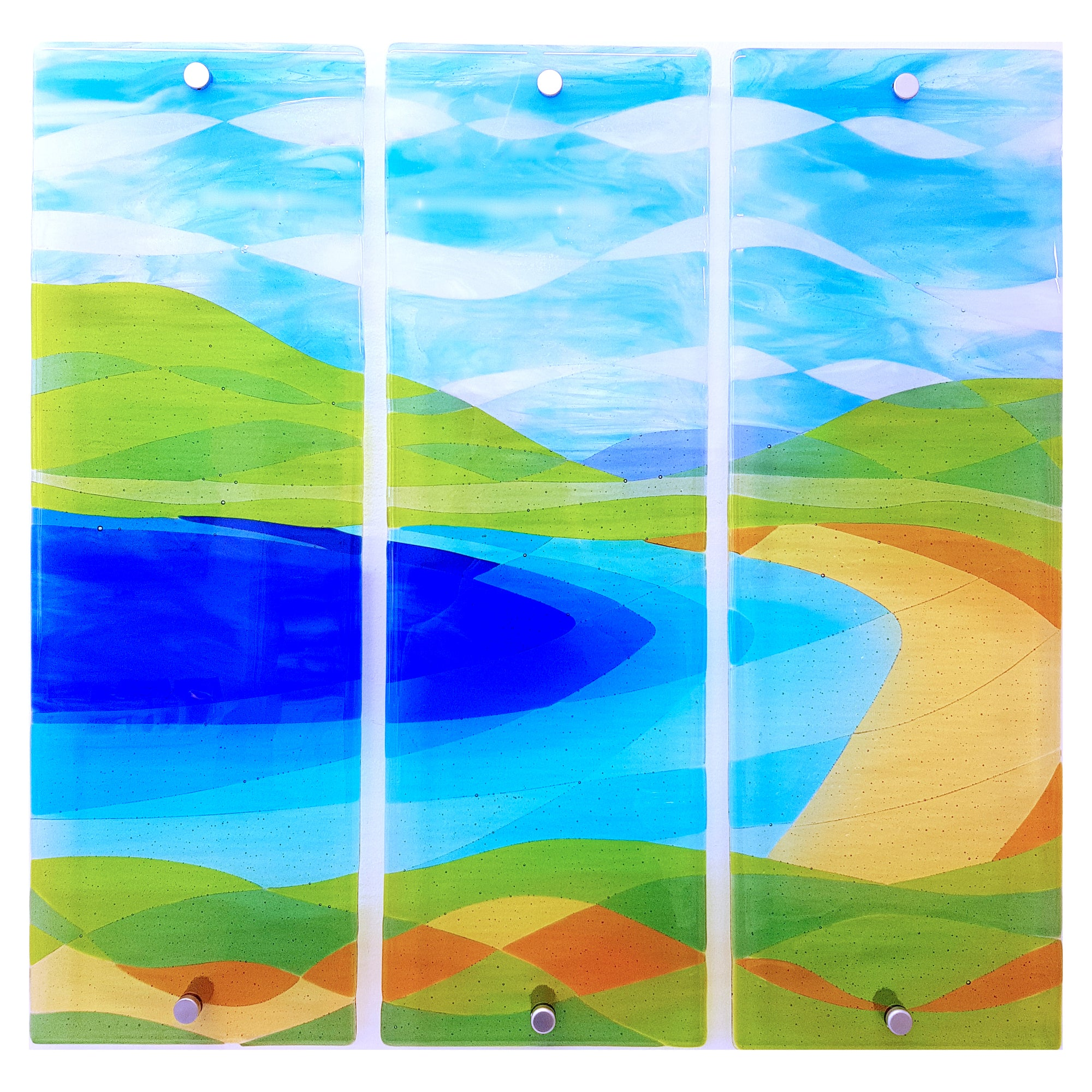 A set of three fused glass wall panels showing Dog's Bay in Connemara, made by Connemara Blue