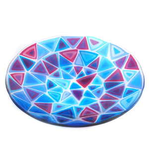 Fused glass bowl featuring stacked pink and blue triangles, made by Connemara Blue
