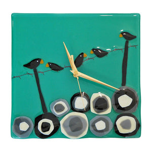 Fused glass clock featuring birds on barbed wire, made by Connemara Blue