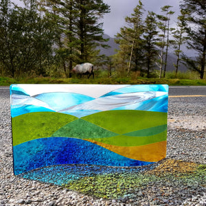 Fused glass freestanding wave featuring the curves and colours of the Connemara landscape, made by Connemara Blue