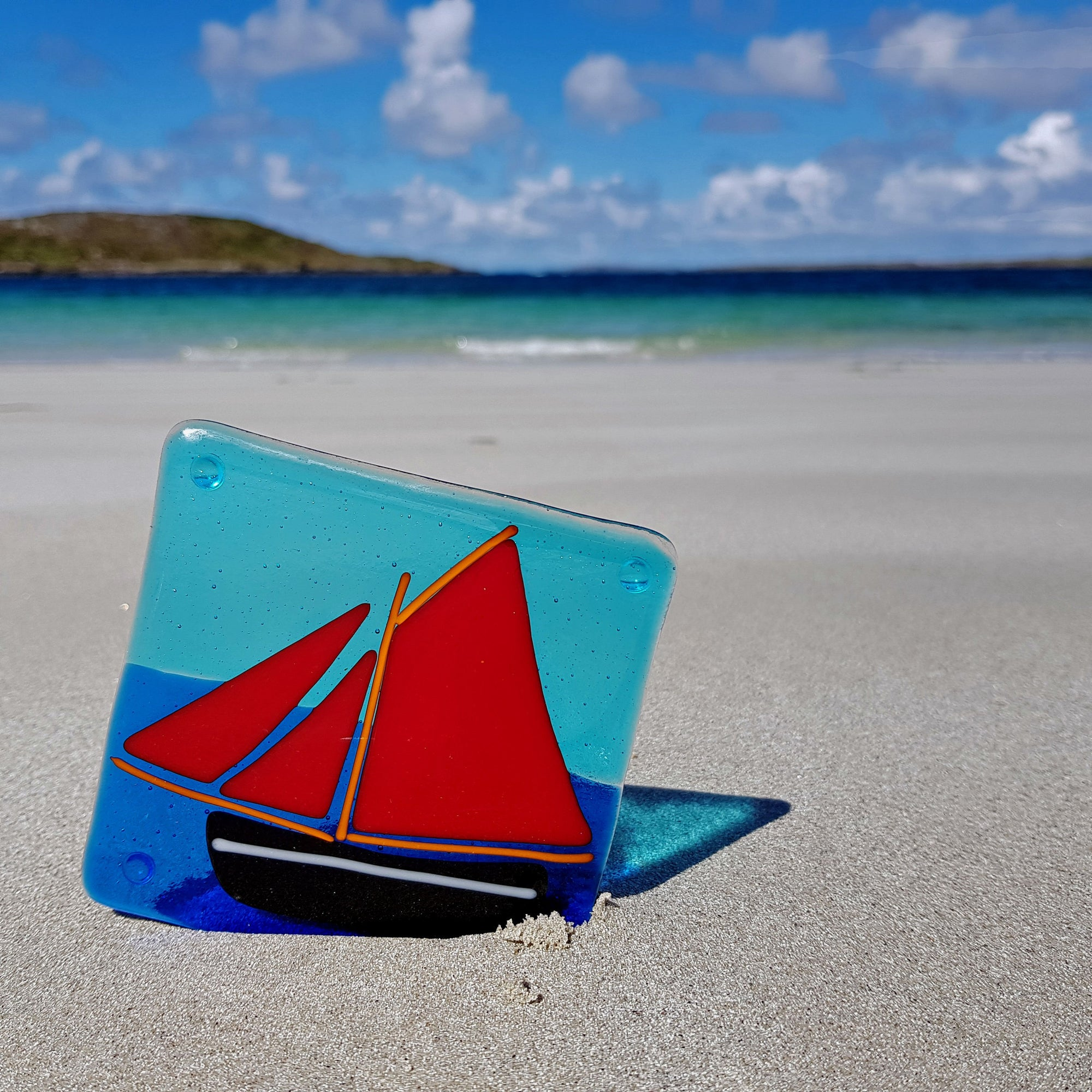Glass coaster featuring the iconic Galway Hooker with her red sails, made by Connemara Blue