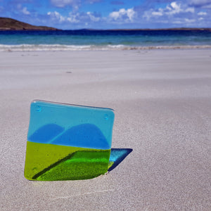 A striking glass coaster featuring the brooding hills of Connemara