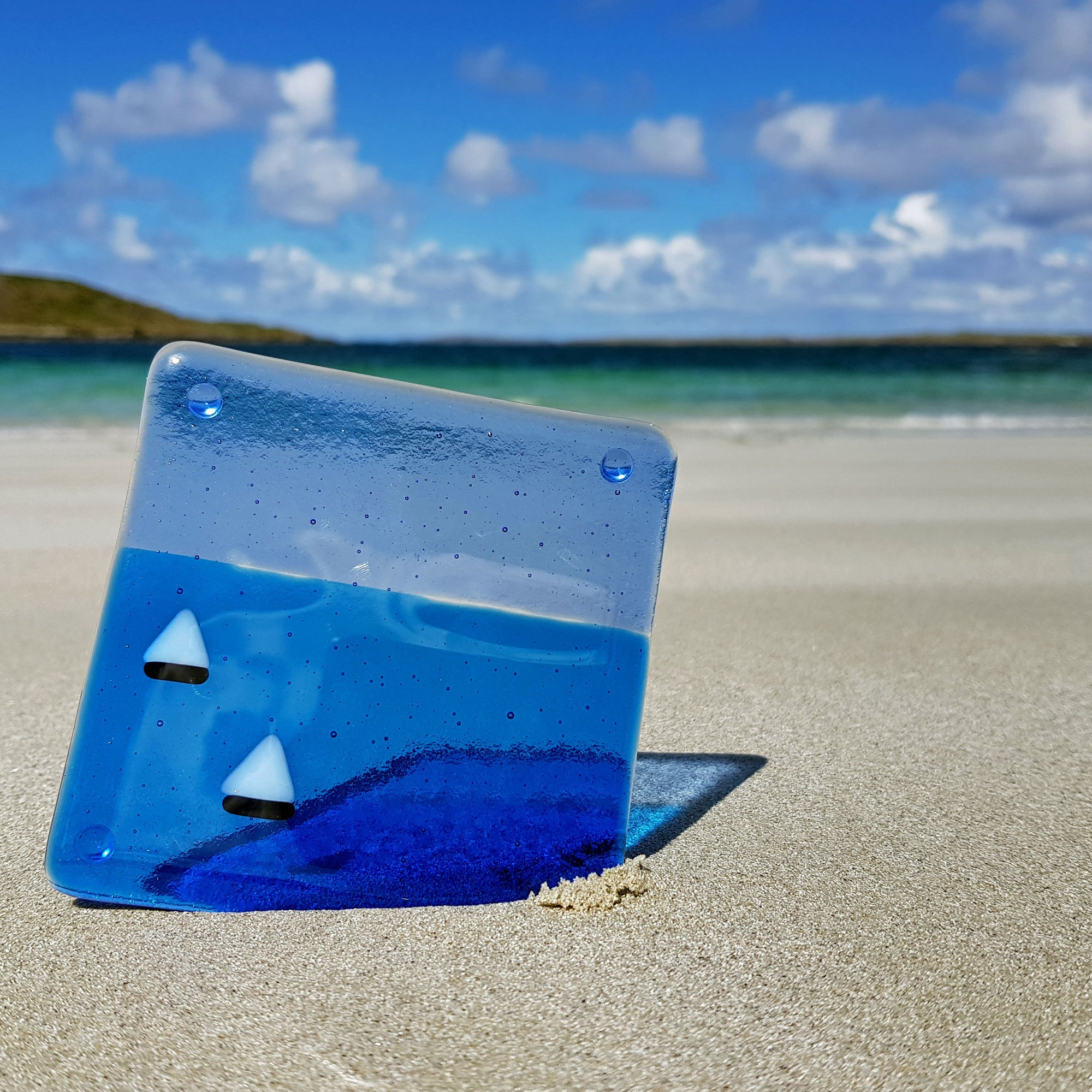 Glass coaster featuring two little boats with white sails on the ocean. Great small gift idea from Connemara Blue