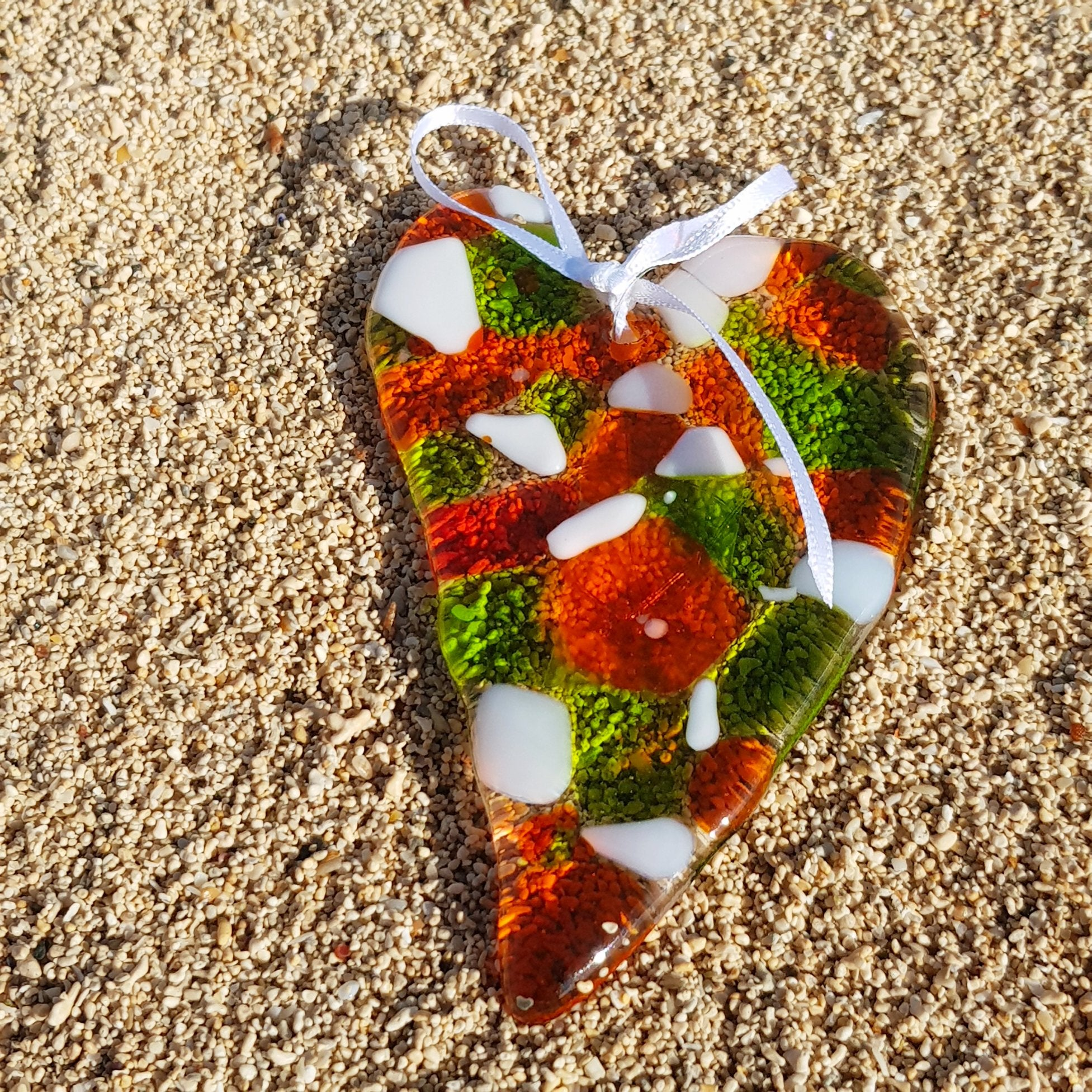 A beautiful glass hanging decoration in the shape of a heart, made in the distinctive colours of the Irish flag. A great small gift idea