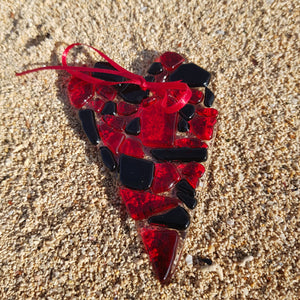 A beautiful glass hanging decoration in the shape of a heart, made with romantic red and black glass