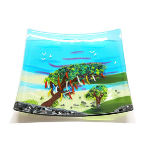 A striking glass plate featuring the iconic windswept fairy tree associated with Connemara