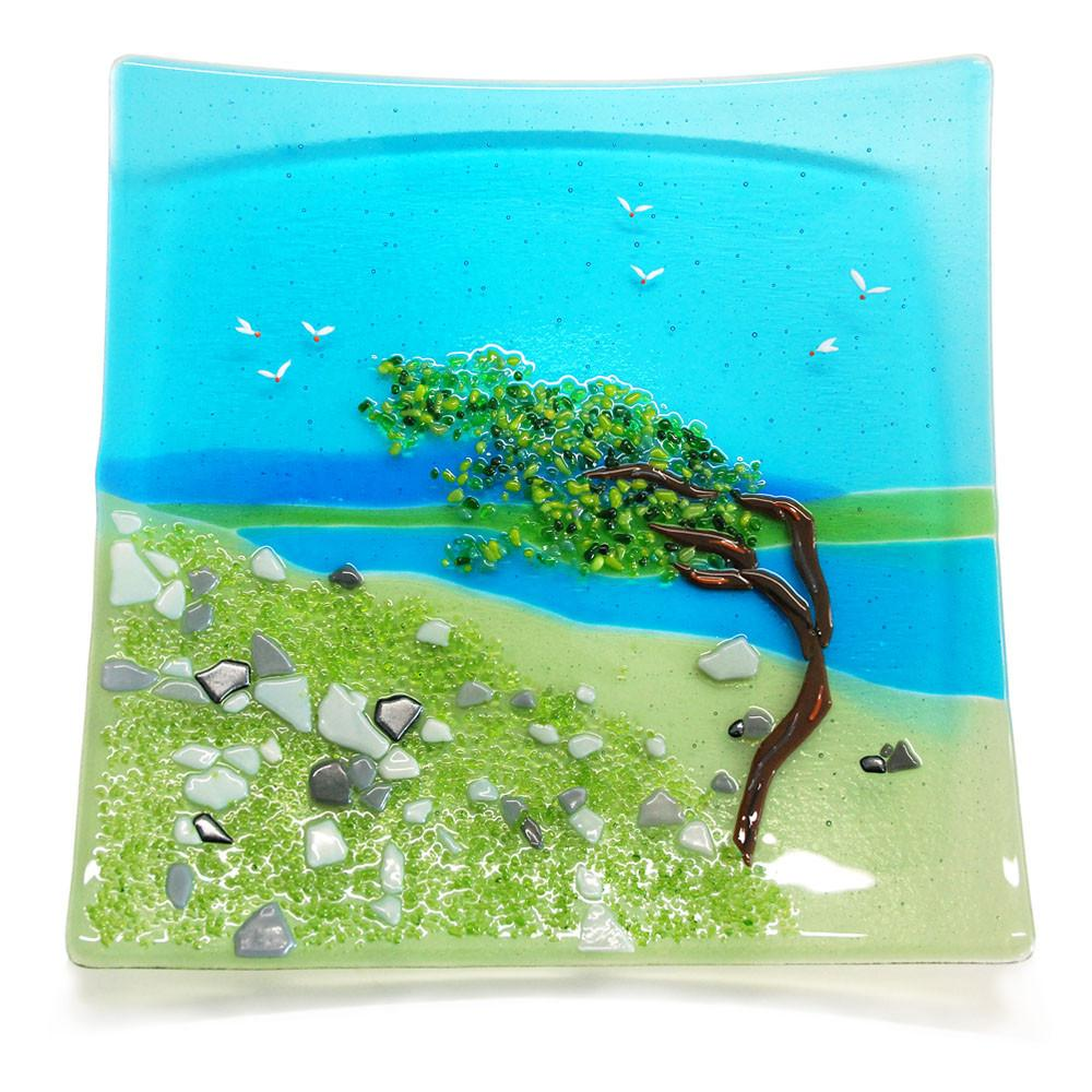 Glass plate featuring a windswept tree and landscape, made by Connemara Blue