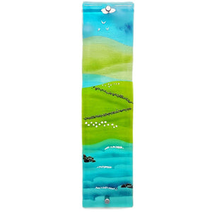 Glass wall art featuring sea, fields, sheep, hills and blue skies; panel 2
