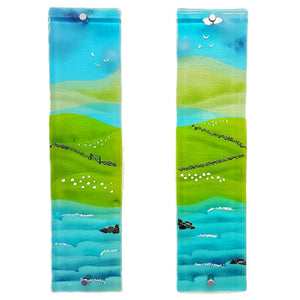 Two glass wall panels featuring a Connemara bay, sheep, fields, hills and blue skies; panels 1 and 2