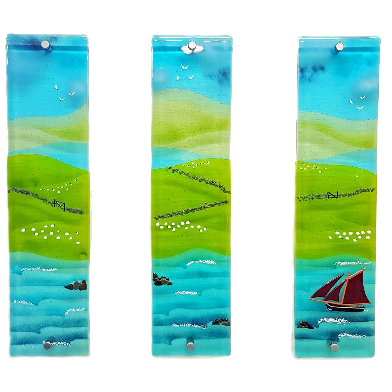 Glass wall art triptych featuring a Connemara Bay, Galway Hooker, sheep, fields and blue skies
