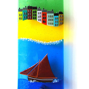 A close up of a Galway Hooker and cosy seafront terraces, taken from the stunning John Conneely's Sheep glass wall panel