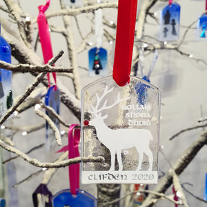 A fused glass Christmas decoration featuring Rudolph the reindeer and Clifden 2020 inscription in white, handmade by Connemara Blue
