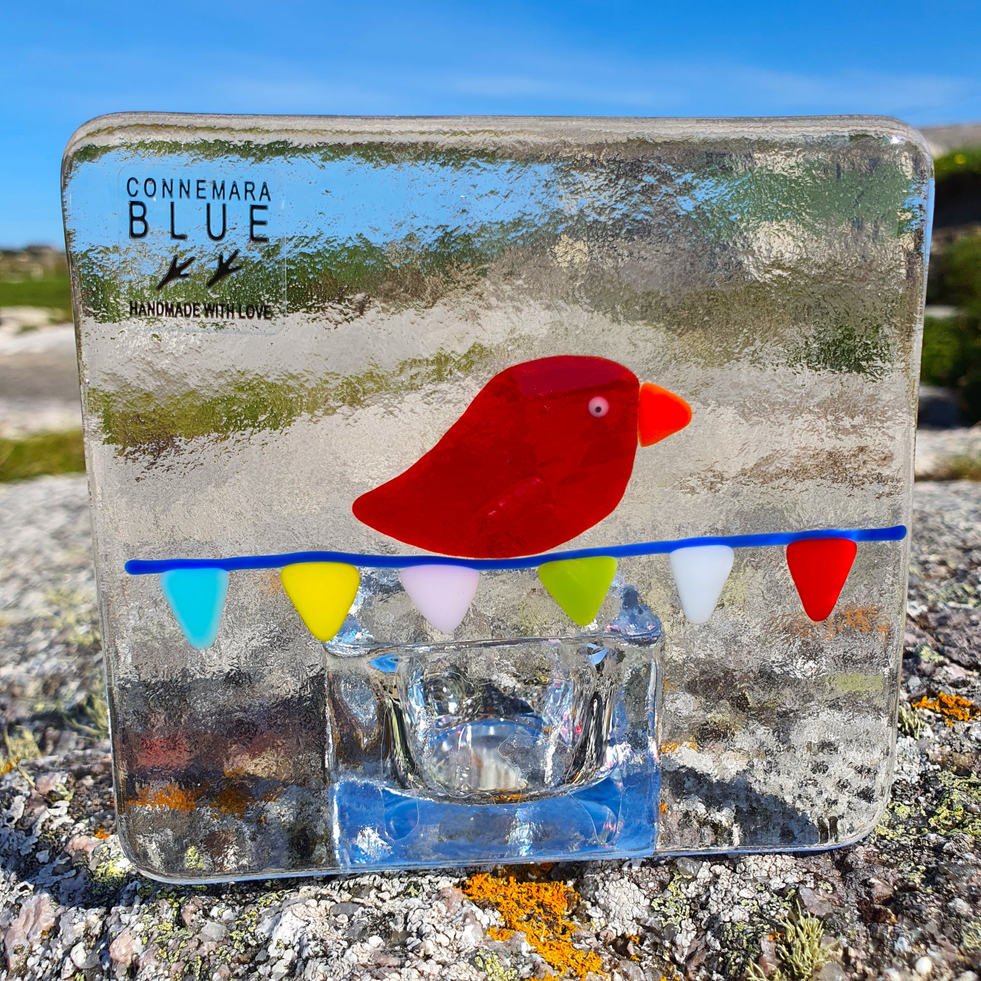 Fused glass tealight holder featuring a red bird on bunting, handmade by Connemara Blue