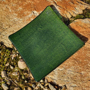 A fused glass square plate in glittery green, handmade by Connemara Blue