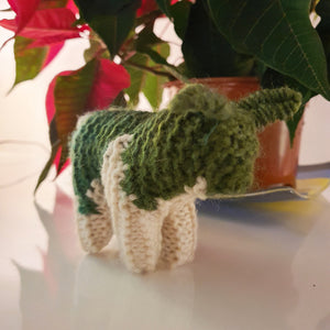 A charming handknitted wool sheep in green and cream, available at Connemara Blue