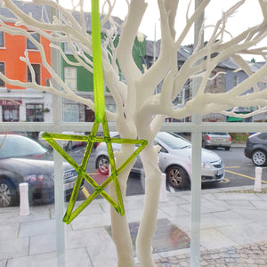 A fused glass transparent spring green star decoration, handmade by Connemara Blue