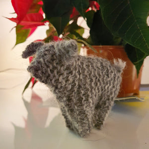A charming handknitted wool sheep in grey, available at Connemara Blue