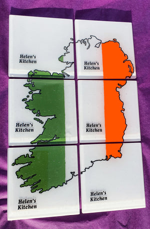 A glass coaster set of six featuring a map of Ireland with name personalisation, handmade by Connemara Blue