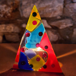 A beautiful fused glass tree-shaped tea light holder in multicoloured glass, handmade by Connemara Blue
